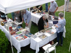 Readers selecting books during the Eureka Springs ninth annual Books in Bloom. Elegant